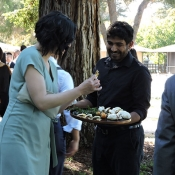 Event guests eating appetizers