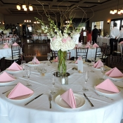 Table for wedding guests with beautiful flower arrangement