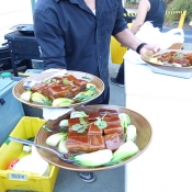 Serving plates of food for wedding guests