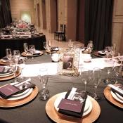 Wedding event menus arranged on plate settings