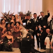 Wedding guests posing for camera