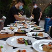 Preparing dishes at event