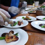 Ginger Cafe team assembling plates at wedding event